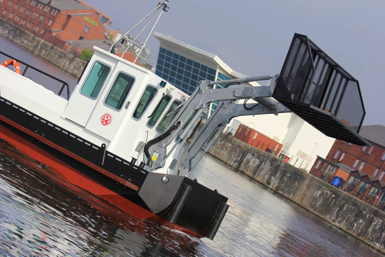 trash skimmer boat for river clean up