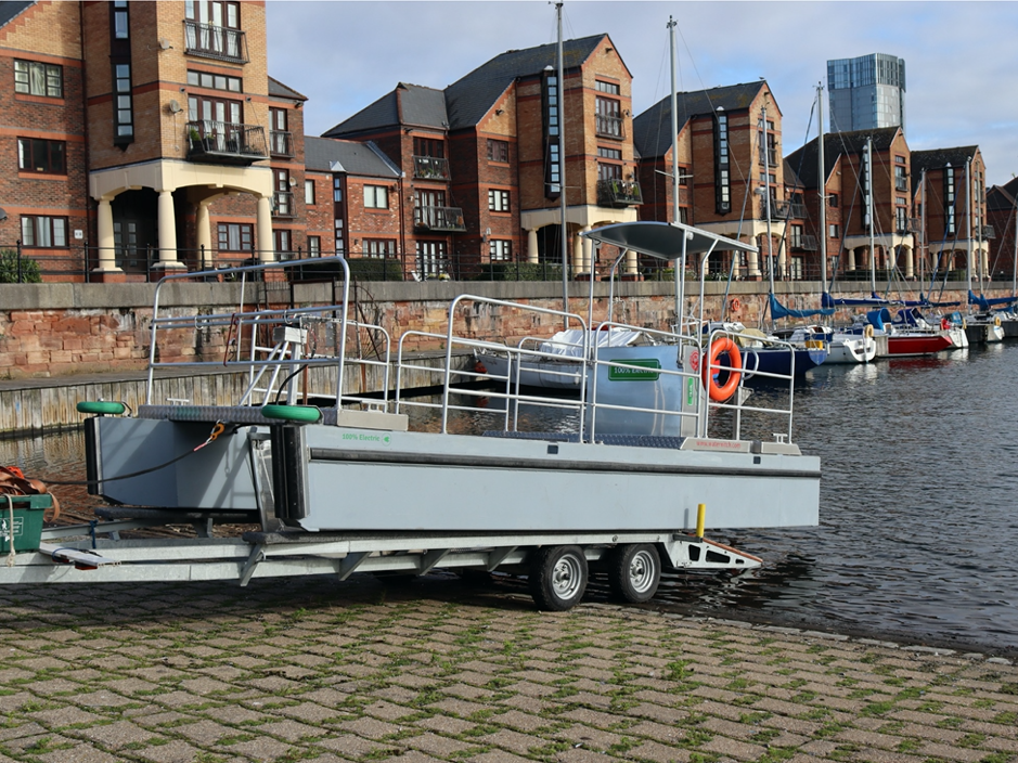 Versi-Cat trash skimmer road transportable workboat