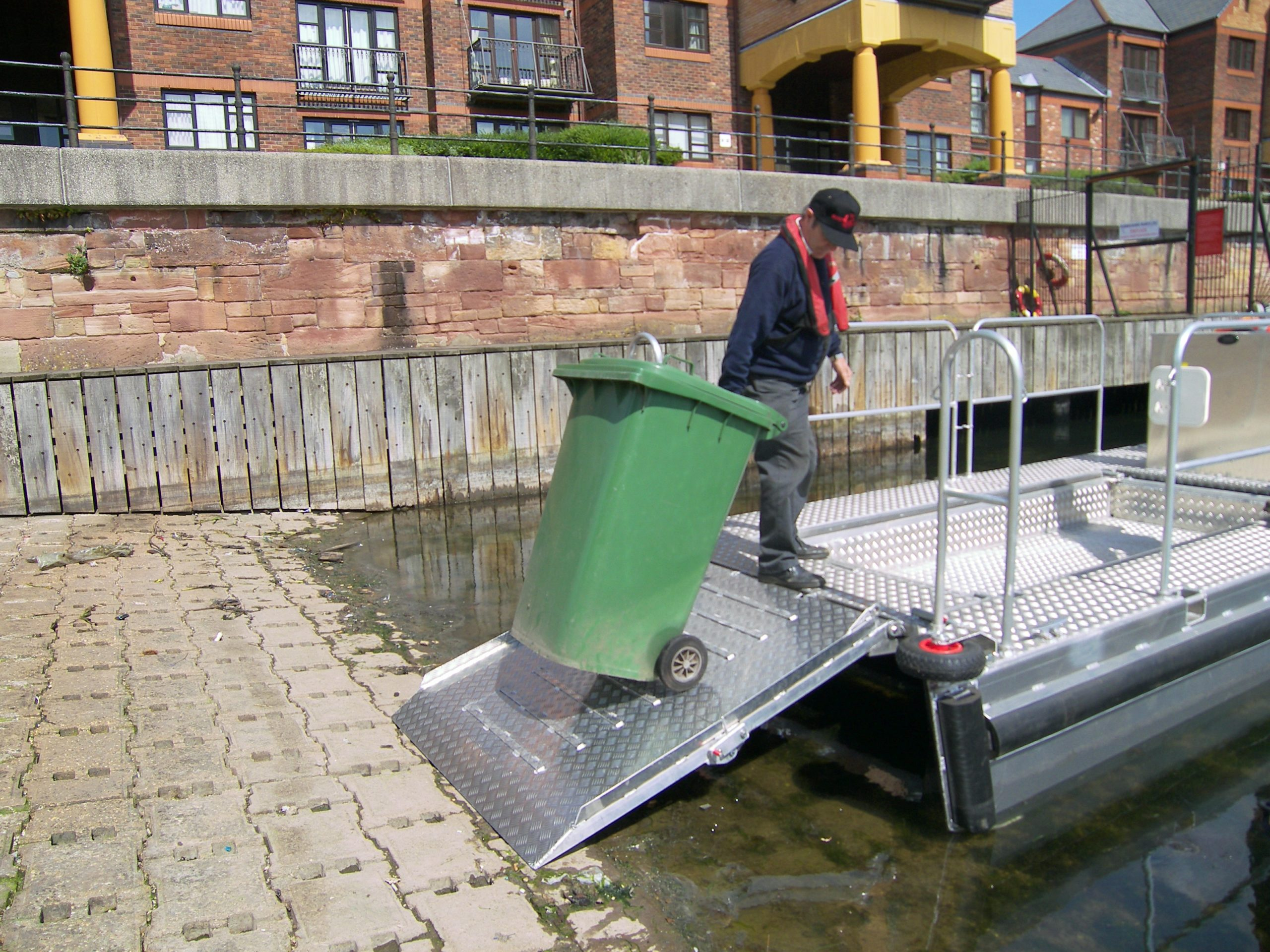 Pontoon Workboat Trash skimmer boat, litter collection boat, marine debris recovery boat