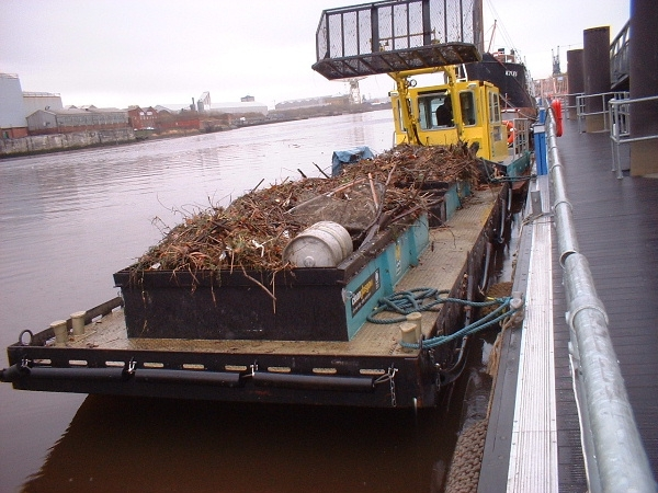 Skip barge for waterway cleanup, trash skimmer river cleanup