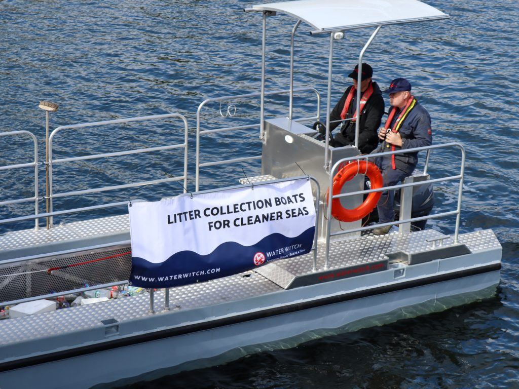 Trash skimmer boat for river cleanup and ocean cleanup