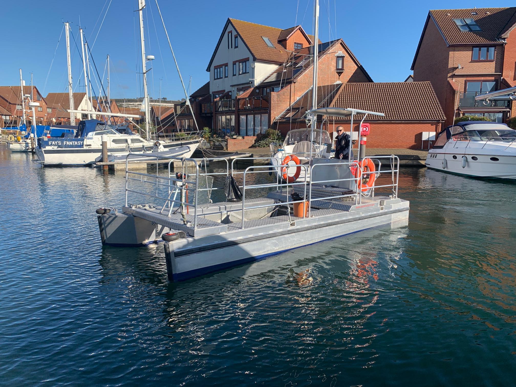 Trash skimmer boat, litter collection boat, marine debris recovery boat